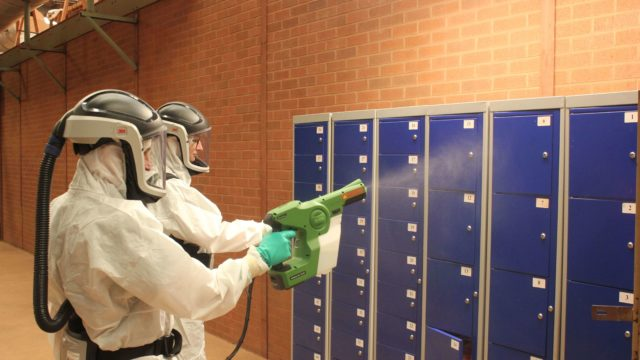 Disinfectant being applied via electrostatic spray